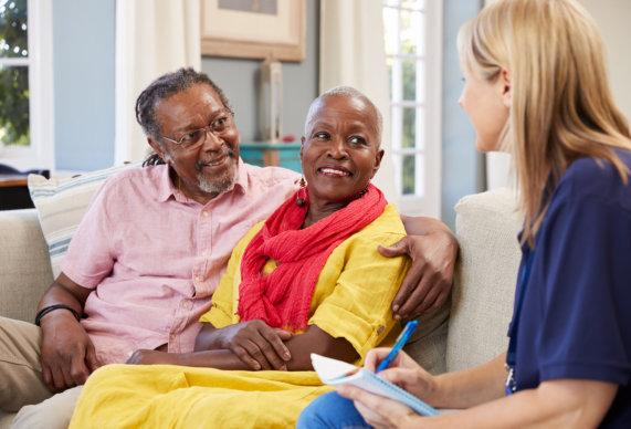 senior couple and their caregiver
