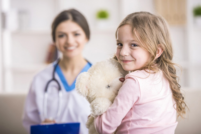 young girl and her pediatrician