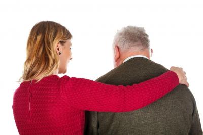caregiver comforting a senior man